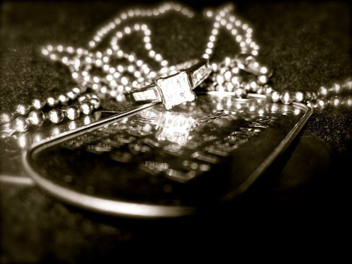 wedding ring and dogtags.