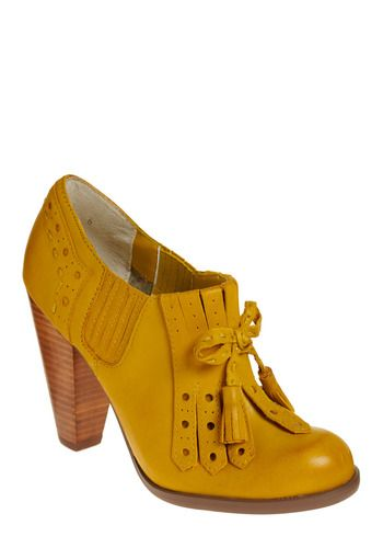 Love for so many reasons...the perfect mustard yellow color, the slightly sexy librarian-ness, the wood heel, the bow,  i could keep going...