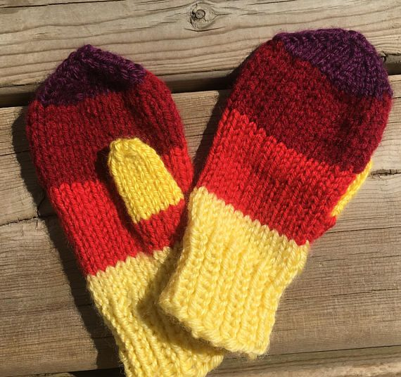 These are hand knit mittens. The toddler mittens are knit on four needles instead of two like most, making them seamless and comfortable. Traditionally knit mittens are knit on two needles and then sewn with a seem and the thumbs are both the same and only ironed over. These are actually knit as a right and a left with opposing thumbs and have no seam. These mittens are knit with a soft acrylic yarn in yellow, red, brick red, gold and purple. They are ideal fro small outings and shopping…