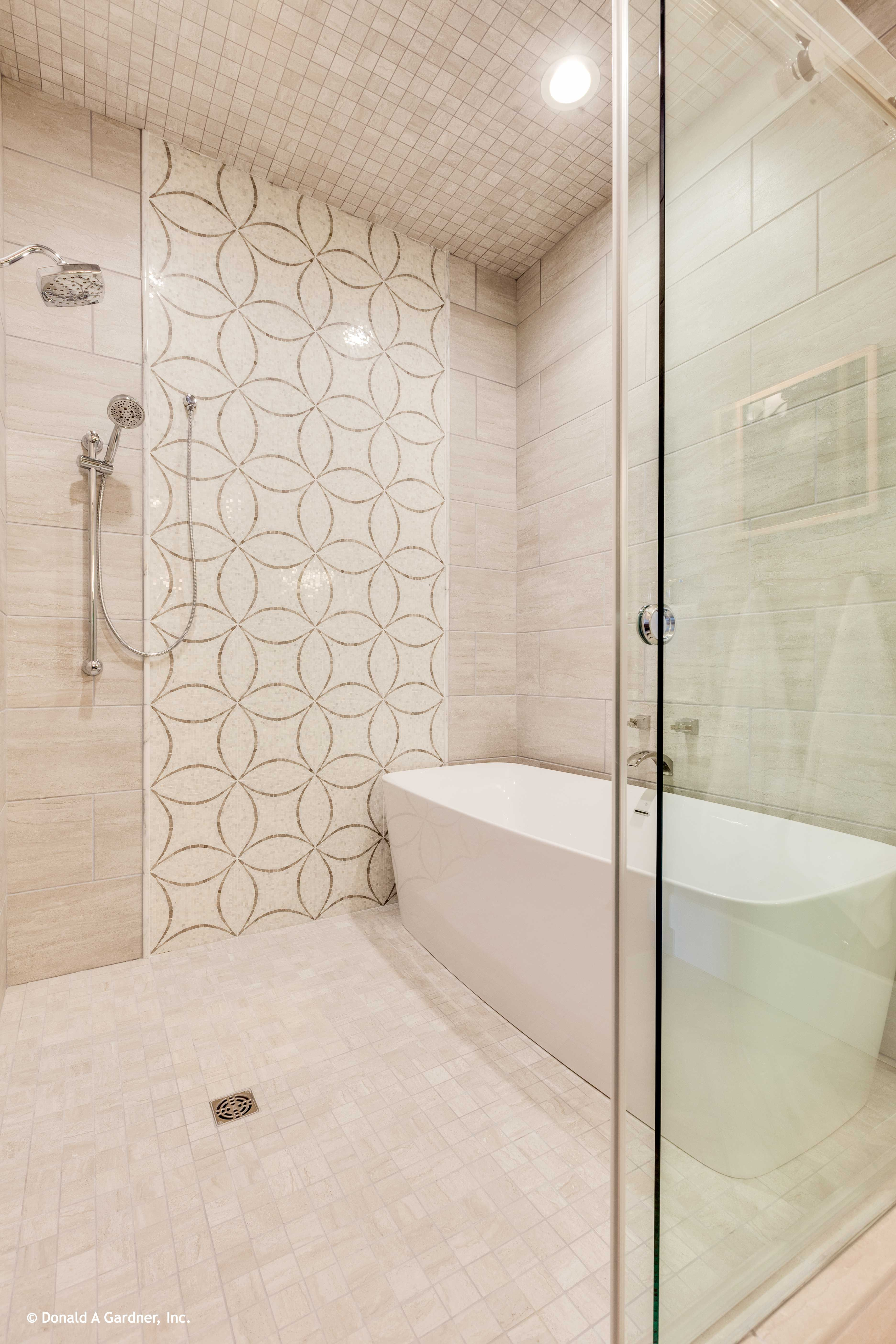 A soaking bathtub is located within the over-sized walk-in shower ...