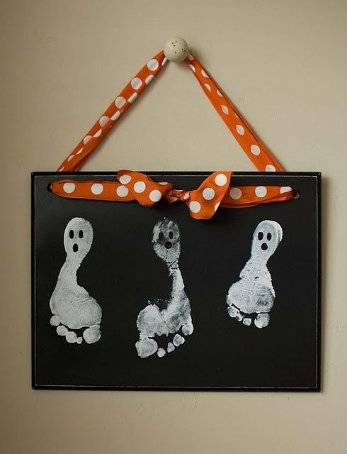 Ghost foot prints! Love that it is hung up by a cute ribbon!