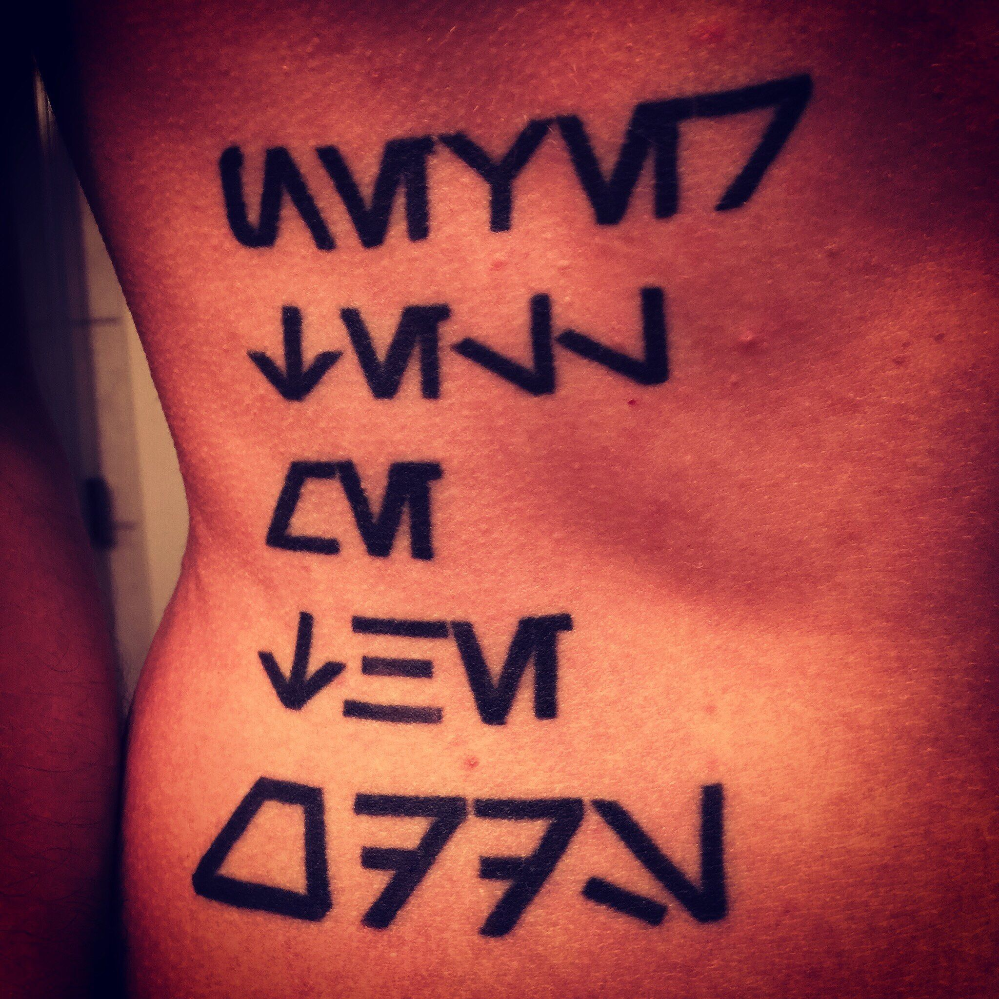 Simple Star Wars #aurebesh tattoo on ribs. \