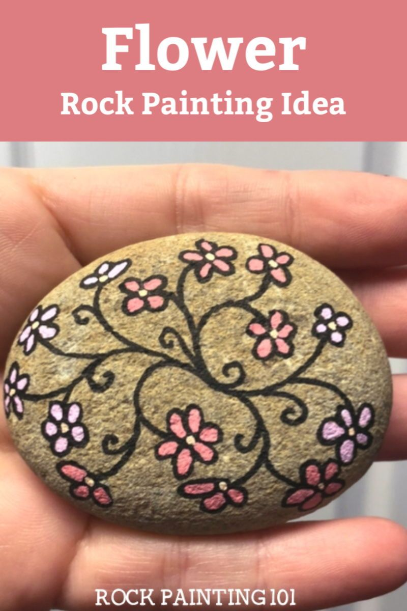 Learn how to paint this easy flower vine rock painting idea. This flower painted rock is the perfect spring rock for the beginner. Give them as gifts or hide them around your city. #rockpainting101 #flowerrocks