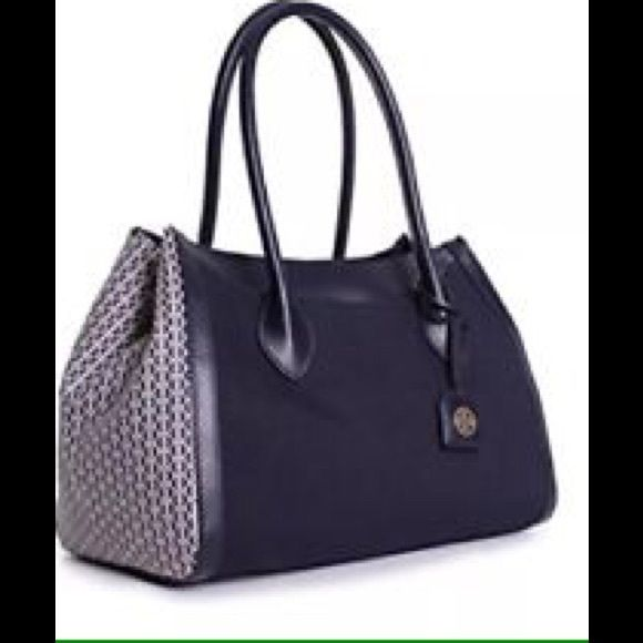 Nwt HUGE Tory Burch Savannah east west tote navy Still in factory wrapping.  Color is navy blue- last photo (red) is for reference only Savannah Tote  Logo-print side panels create a now-classic signature motif on a chic cotton-canvas tote with a capacious interior that easily holds all your workweek or weekend essentials.  Features Include: Cotton Canvas Exterior Logo-Jacquard Lining Magnetic Snap Closure Removable Luggage Tag Exterior Magnetic Snap Pockets Interior Zip, Wall & Cell Phone…