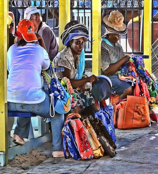ladies selling there goods in Saint Maarten This kinds looks like a painting