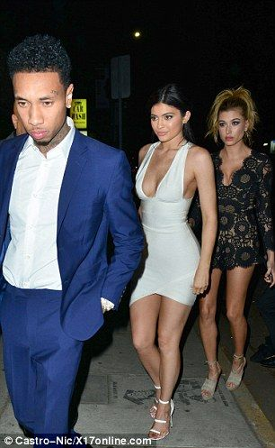Also there was a glum-looking Tyga, 26, who had on a royal blue suit and white shirt...