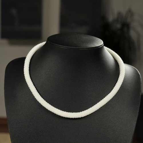 Unique handmade white bead necklace made of white beads and thread.