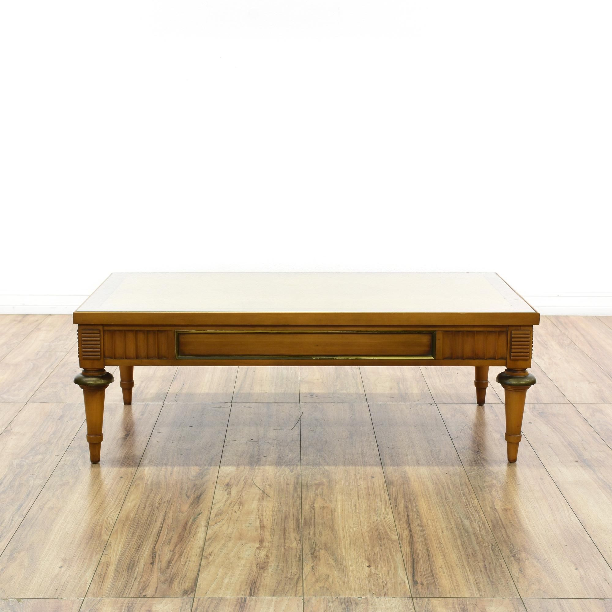 "This ""Lane"" coffee table is featured in a solid wood with a glossy"
