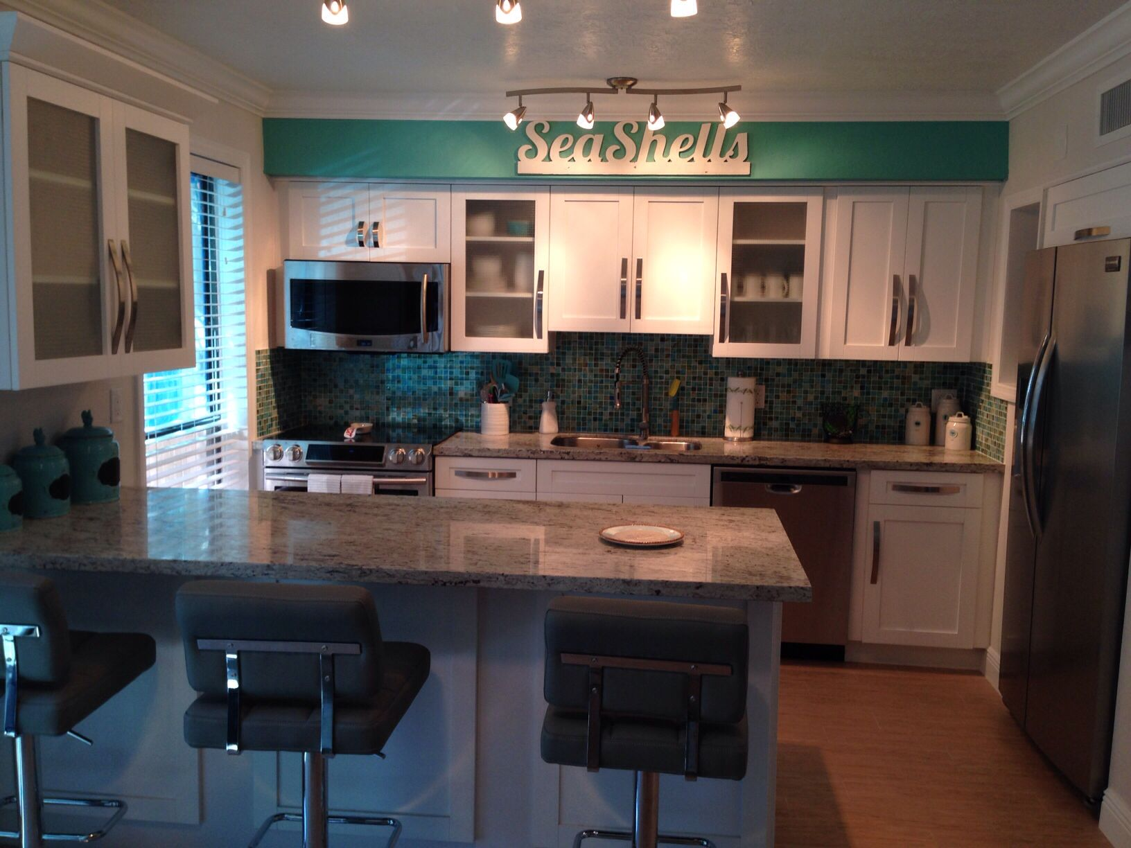 Kitchen Cabinets By Panda Granite River White Paint Color Sw Eidel White Sw Cooled Blue Kitchen Kitchen Cabinets Home Decor