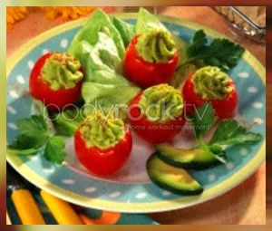 Stuffed tomatoes with avocado: 6-8 small tomatoes, some sheets of lettuce to the sideboard, 1 garlic toe, 1 avocado, 2 Tbsp lemon juice, salt, cayenne pepper.  Cut off a lid from each tomato and extract the flesh. Chop garlic and mash together with lemon juice and avocado.  Season with salt and pepper.  Pipe avocado cream with a star tip in the tomatoes.