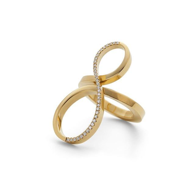 Forged in 18ct yellow gold, this sweeping form has a mirror shine - statement form