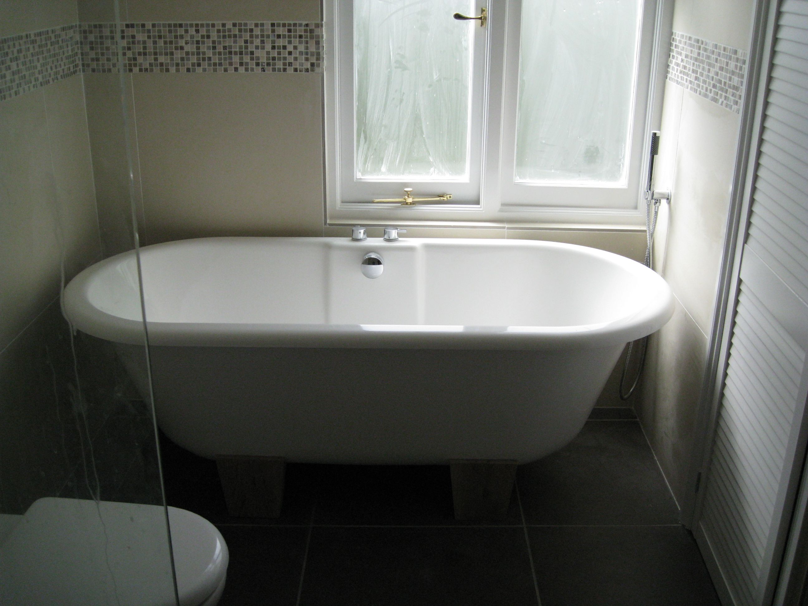 You really can make a freestanding bath look good in a for Tight space bathroom designs