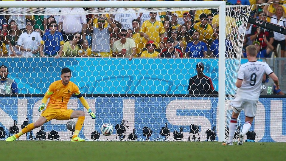 Hugo Lloris of France saves the shot of Andre Schuerrle of