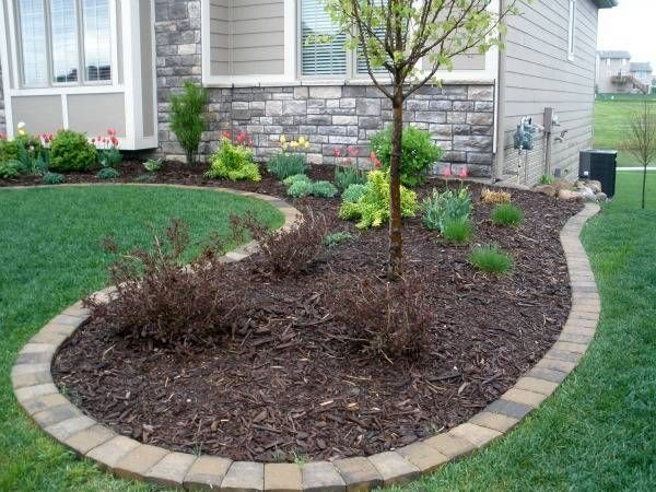 Edging mulch drainage solutions des moines iowa for Landscaping rocks des moines