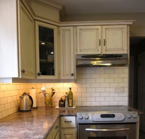 Cream Subway Tile Backsplash With Brown Grout