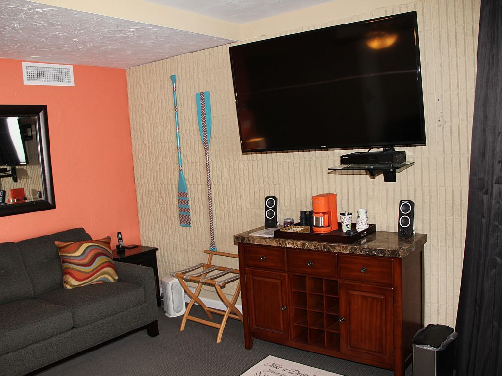 Coffee bar queen sofa sleeper and 60 tv in the master