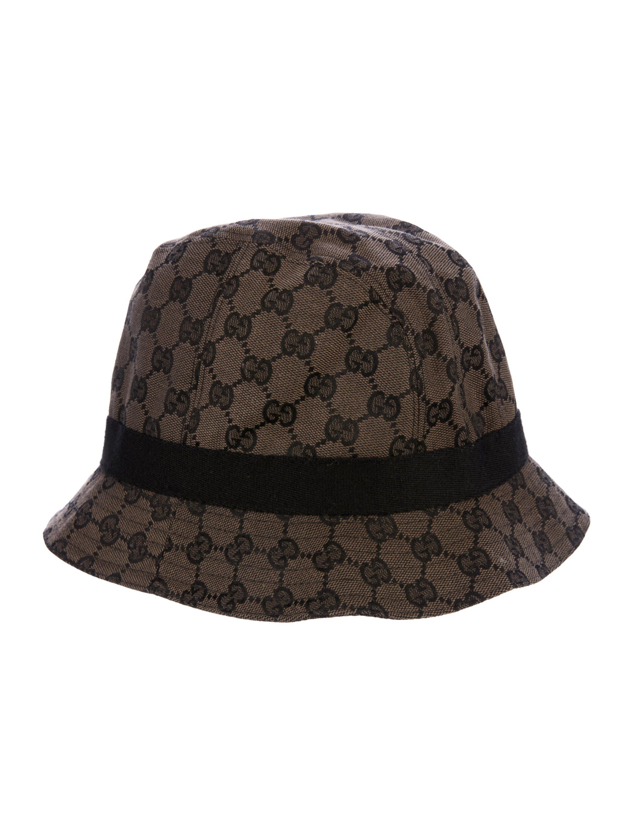 90abe9bd8f3 Black and brown Gucci jacquard bucket hat featuring GG pattern throughout  and grosgrain band.