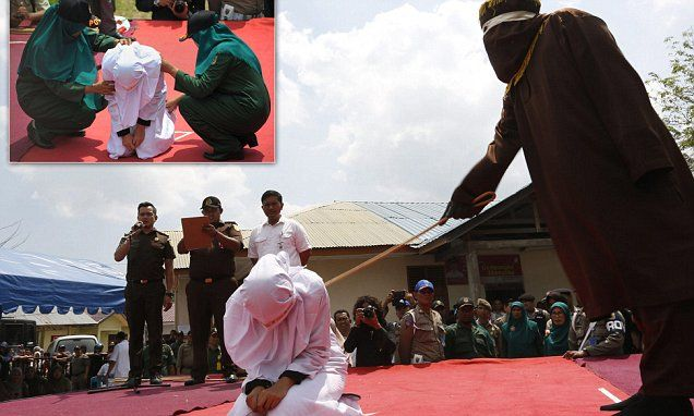 005 Indonesian woman is whipped in front of a crowd for dating