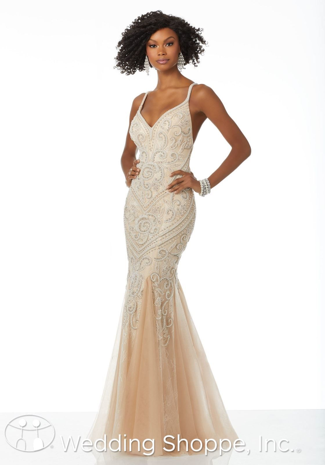 7d740b74483 Slim fit and flare prom dress with intricate beading and a deep V-neck and  open V-back. Unique