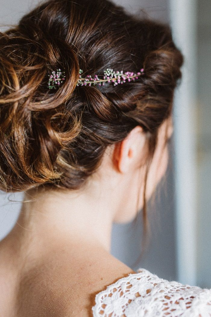The romantic updo of large curls, the delicate wild flower hair ornaments | i take you