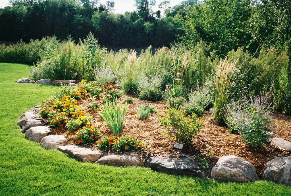 boulder and shrub berm landscaping