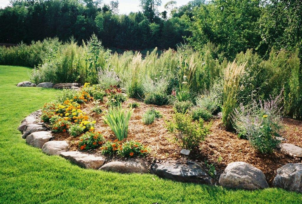 Boulder and shrub berm landscaping berms for flood for Grass shrubs landscaping