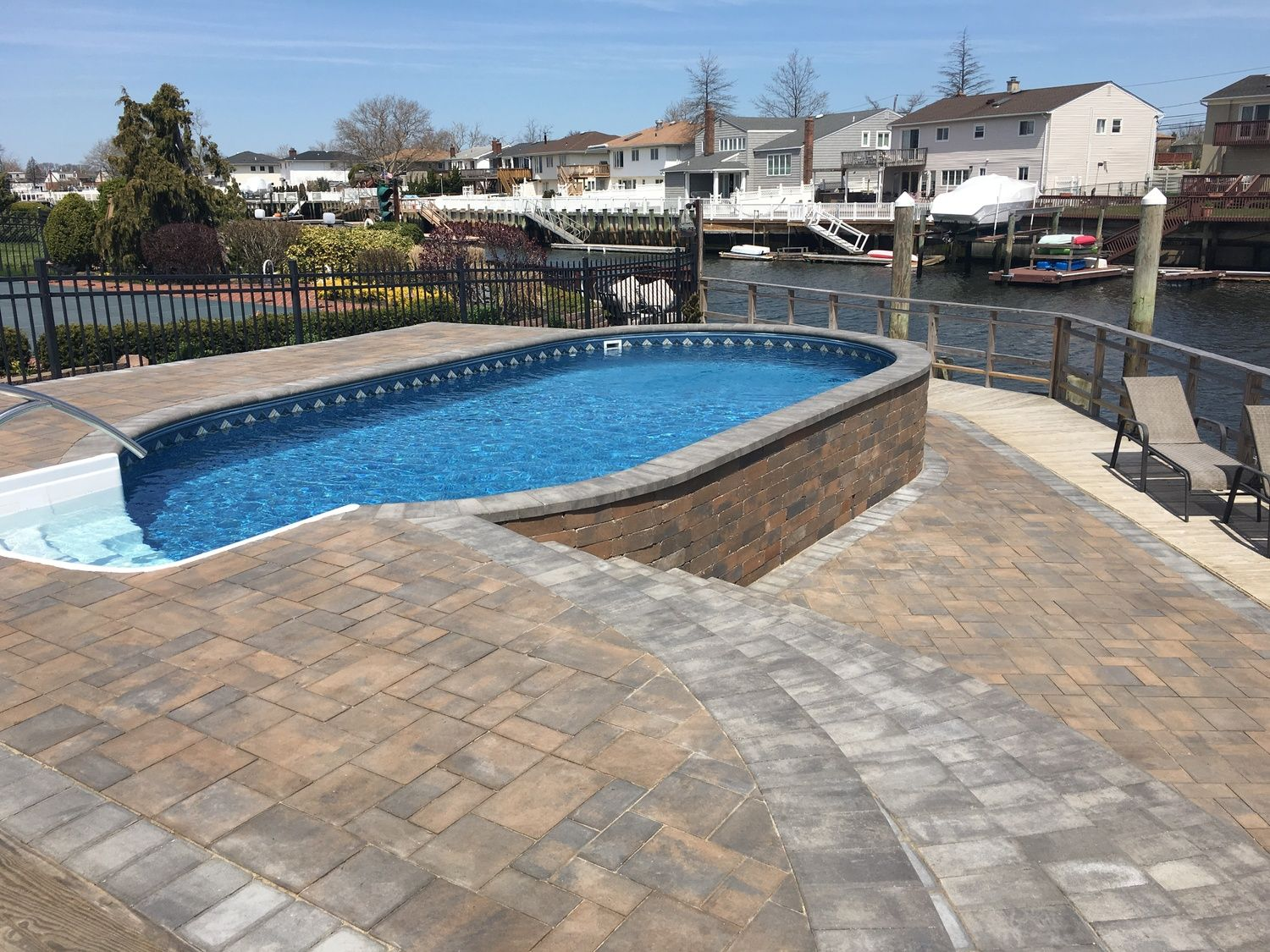 Radiant Semi Inground Oval On The Waterfront Swimming Pools Backyard In Ground Pools Pool Landscaping