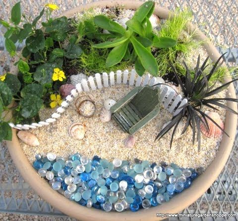 Miniature Fairy Gardens With A Beach Theme In Pots And Baskets