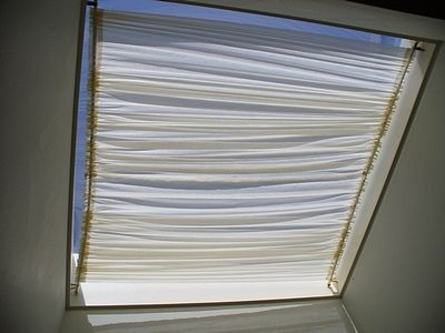 Make something like this for skylight windows but with shade-screen material?  Hold up with tension rods?  http://musepeggy.hubpages.com/hub/How-to-Make-a-Skylight-Shade