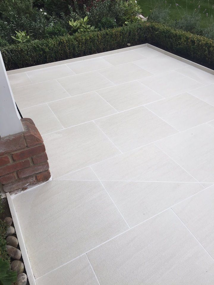 Arbour design and build used our sandy white porcelain to for Bath patio slabs