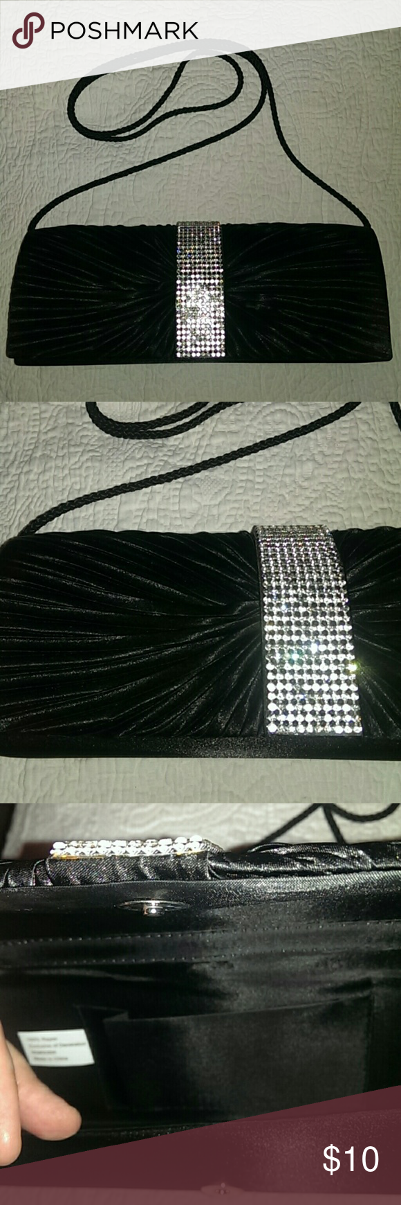 """3 for $15 Satin-like black clutch, w/ rhinestones I bought this years ago, but never used it. Black gathered satin-feel clutch with rhinestone decorations. Snap closure front, braided cord strap. Some rhinestones missing, some scuffs, marks, and manufacturing flaws.  Dimensions: 10"""" x 4"""" x 1.5""""  Questions and offers encouraged! Bags Clutches & Wristlets"""