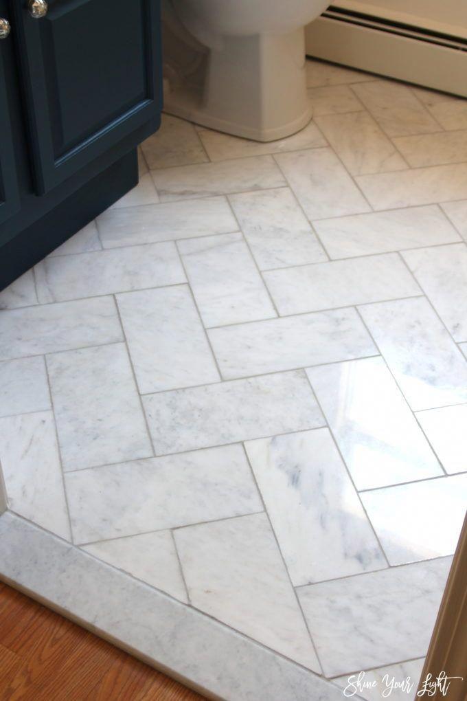 Large Herringbone Marble Tile Floor A Great Tip To Diy It For Less Diyremodeltip With Images Herringbone Tile Floors Marble Tile Floor Bathroom Floor Tiles