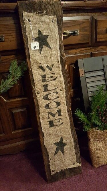 Burlap stenciled Welcome attached to barnwood