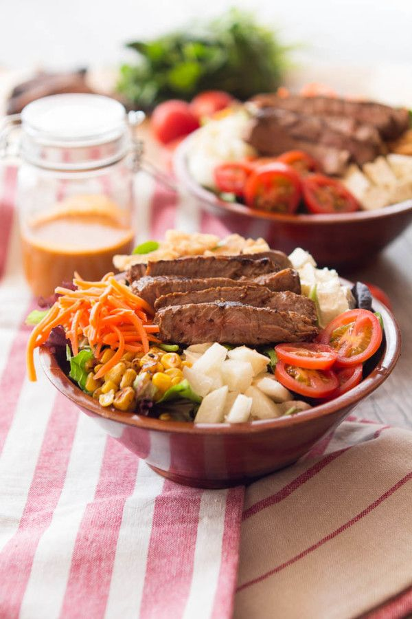 chipotle dressing, marinated steak, tomatoes, carrots, corn, spring mix, southwest salad, spicy