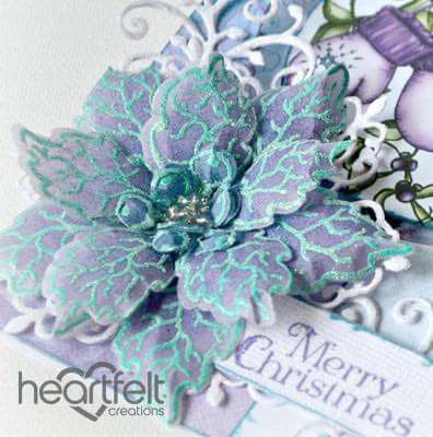So unusual but so effective! Stamp your poinsettias and heat emboss in teal and then colouring the vellum in purples! Wow!