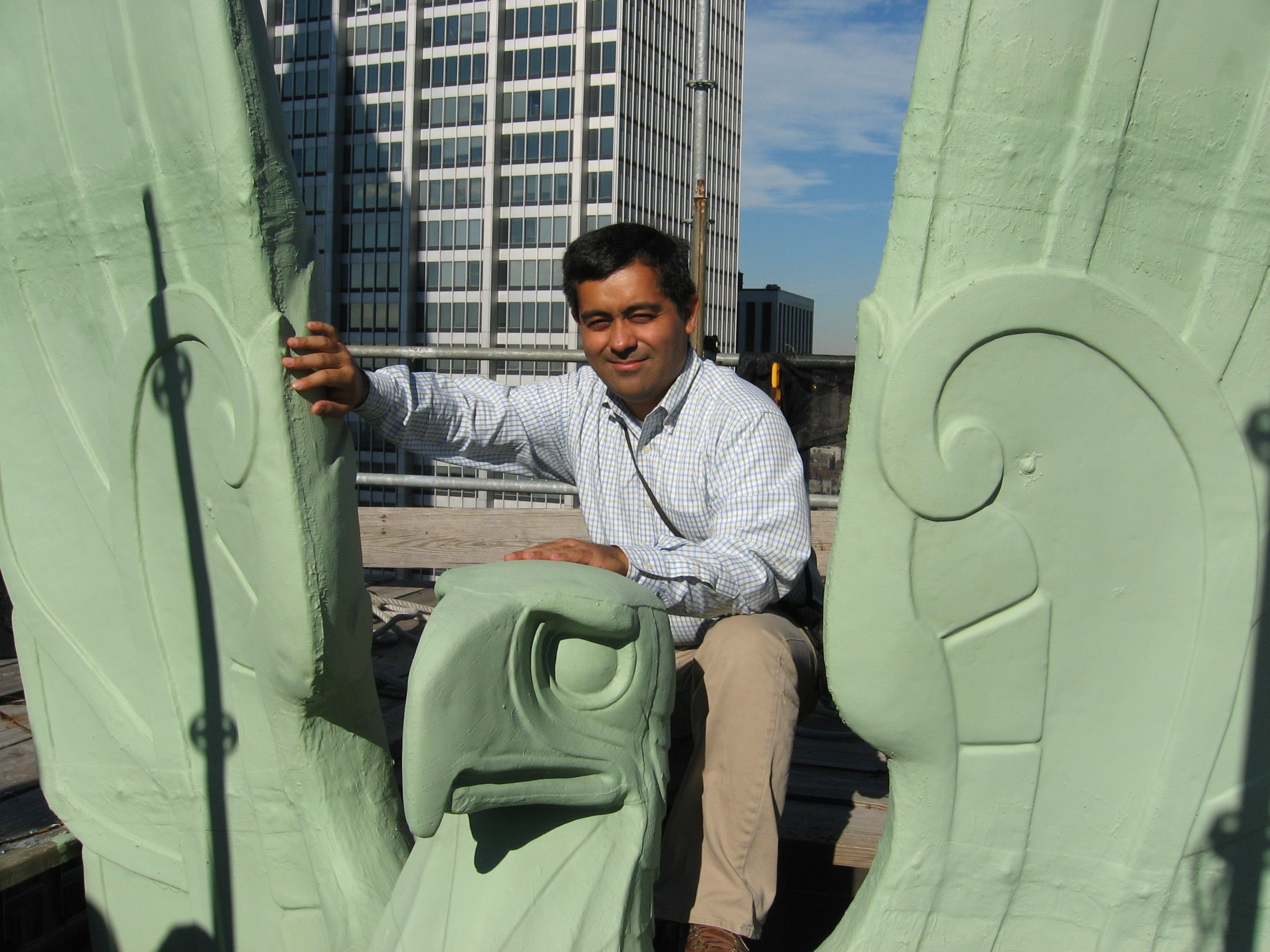 Our intrepid architects: Juan Kuriyama, AIA sits astride the eagle crowning 48 Wall Street in New York.