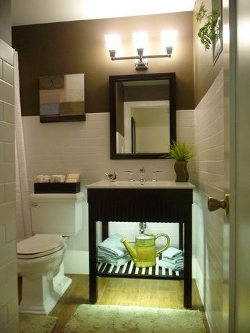 """Small bathroom made to look larger. Undercabinet lighting for night light and ambience. White matte subway wall tile, wood flloor tile, contrasting paint - Benjamine Moore Brown Horse - to make the white tile """"pop"""". Nautical accent colors. Heated floor, Corian shower pan, walk-in shower"""