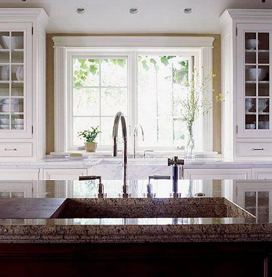 Love the idea of the cabinets flanking the window and for Ideas for things to put on top of kitchen cabinets
