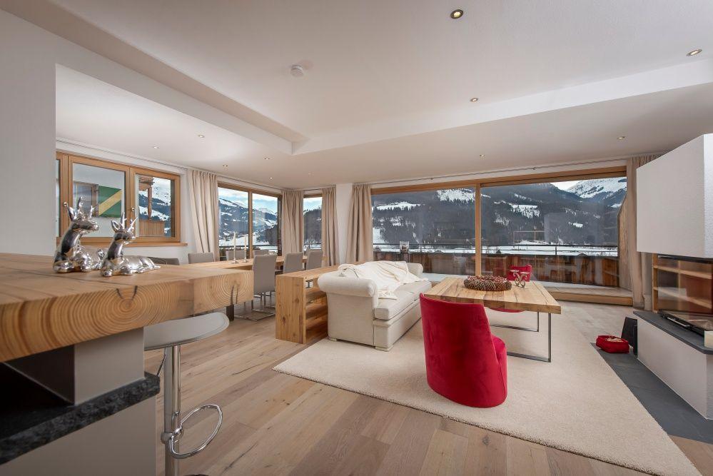 Excellent Immobilie Kitzbhel Luxus Wohnzimmer Mit Kaminofen Im Modernen  Alpenstil With Alpenstil Einrichtung