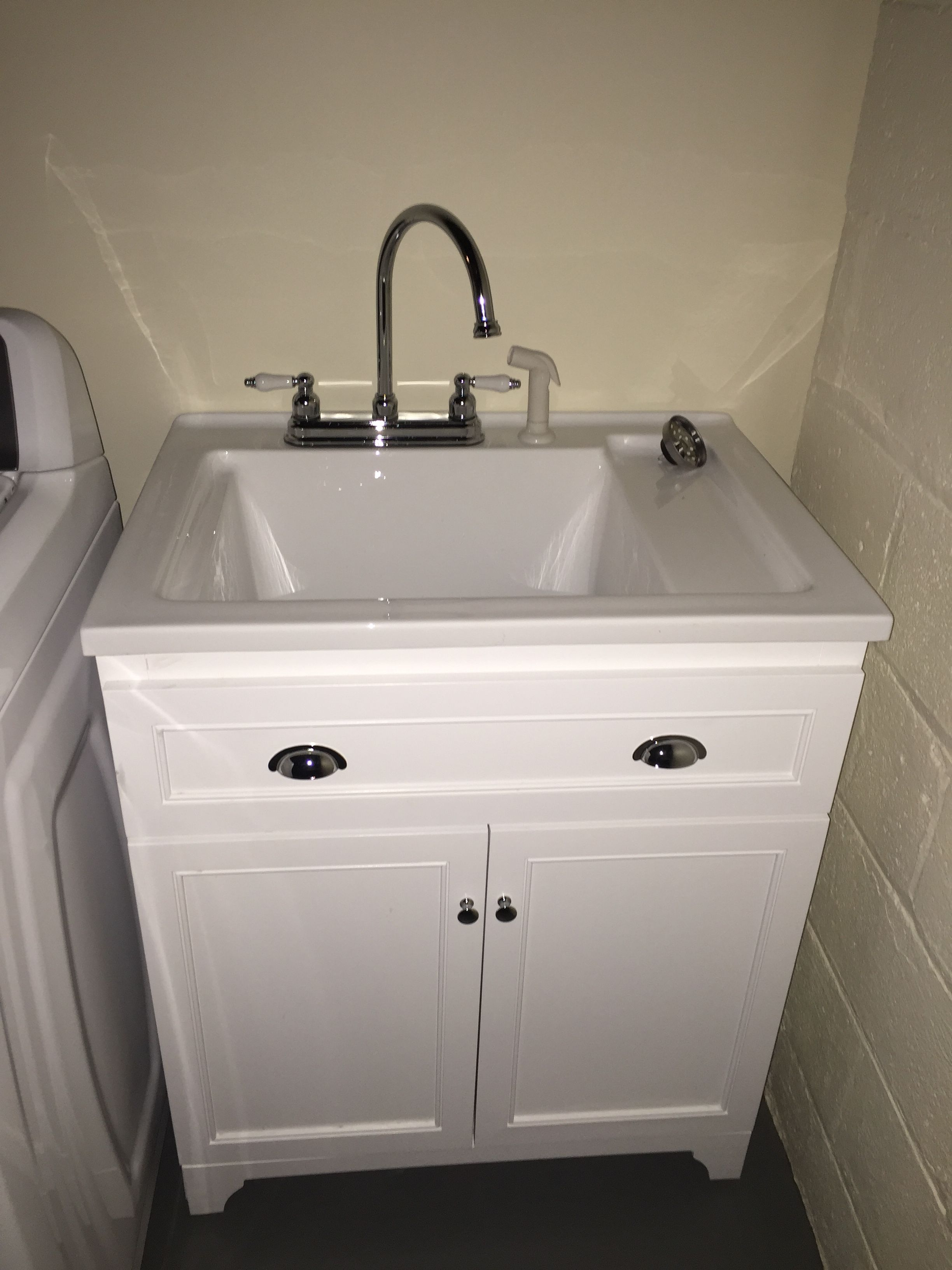 Basement laundry room remodel. We installed track lighting, washtub with faucet, painted walls and ceiling. #bigbearremodeling
