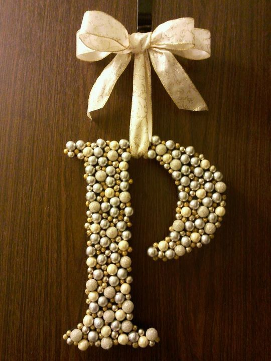 Letter 'wreath' made by gluing Christmas berries from the craft store to a wood letter.  Gorgeous!
