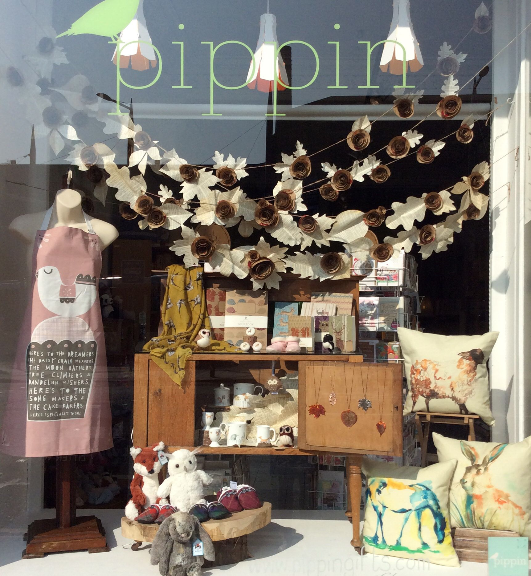 Our autumn window display woodland animals cosy for Retail shop display ideas