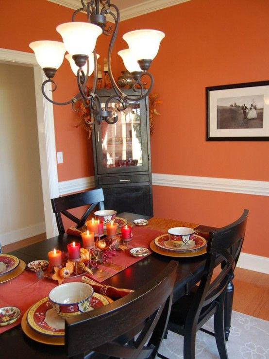 Interior Beautiful Chandelier Hanging Above Black Dining Chairs And Table With Thanksgiving Decor Utilizing Red Candles Various Candle