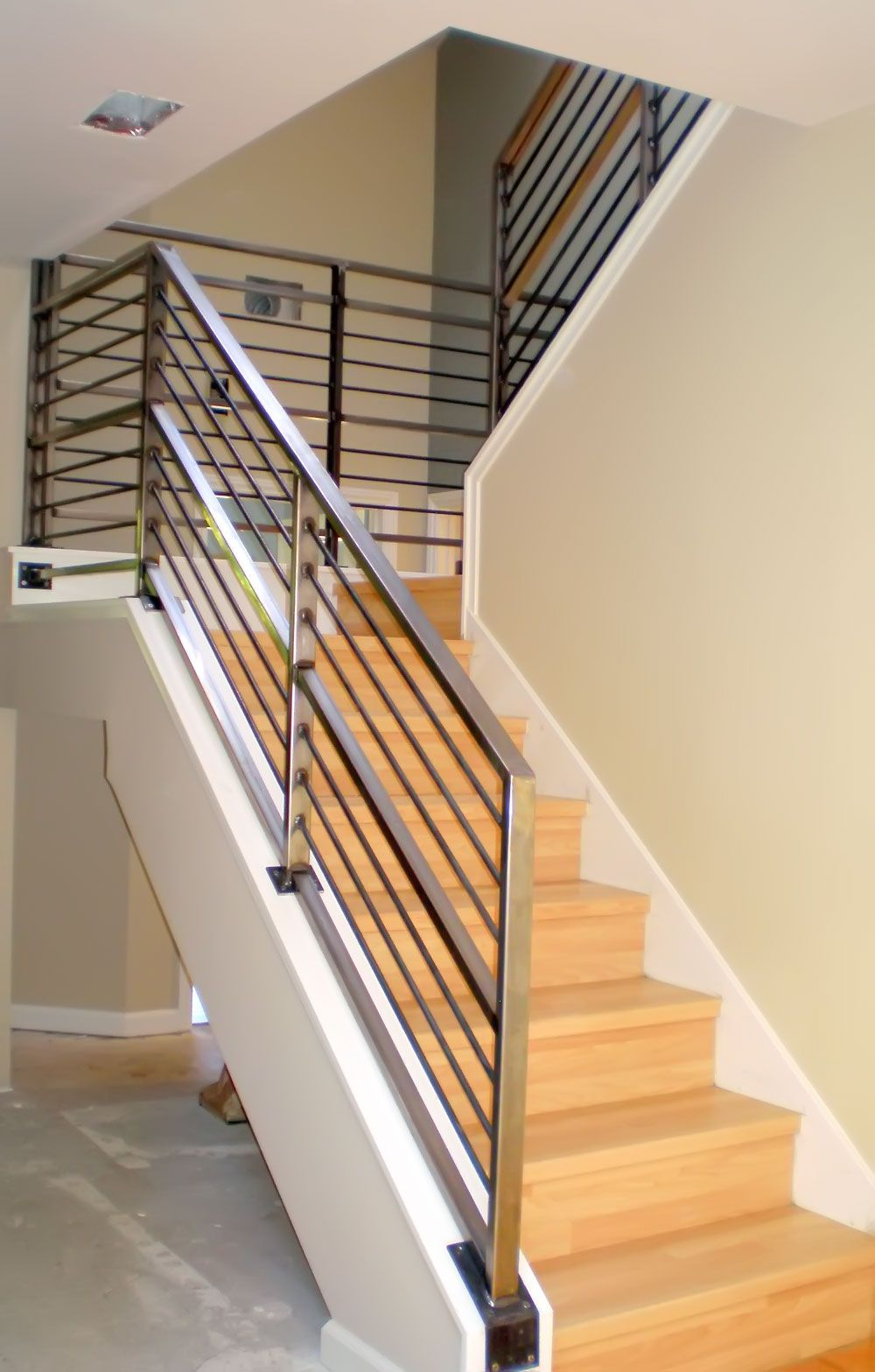 Attractive Modern Neutral Wooden Staircase With Minimalist Steel Railing .