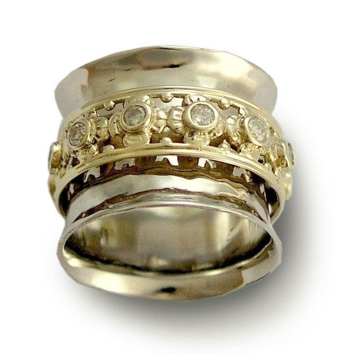 Wide 14k white gold band with yellow gold spinner inlaid diamonds