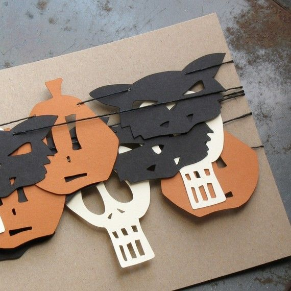 gift garland... this could be very inspiring, you can replace those faces by Christmas trees or birthday candles