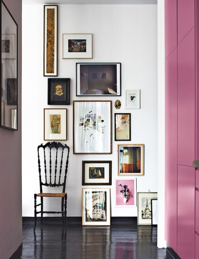 I love the way the furniture is part of the wall art collection here. And, that long thin picture... beautiful!