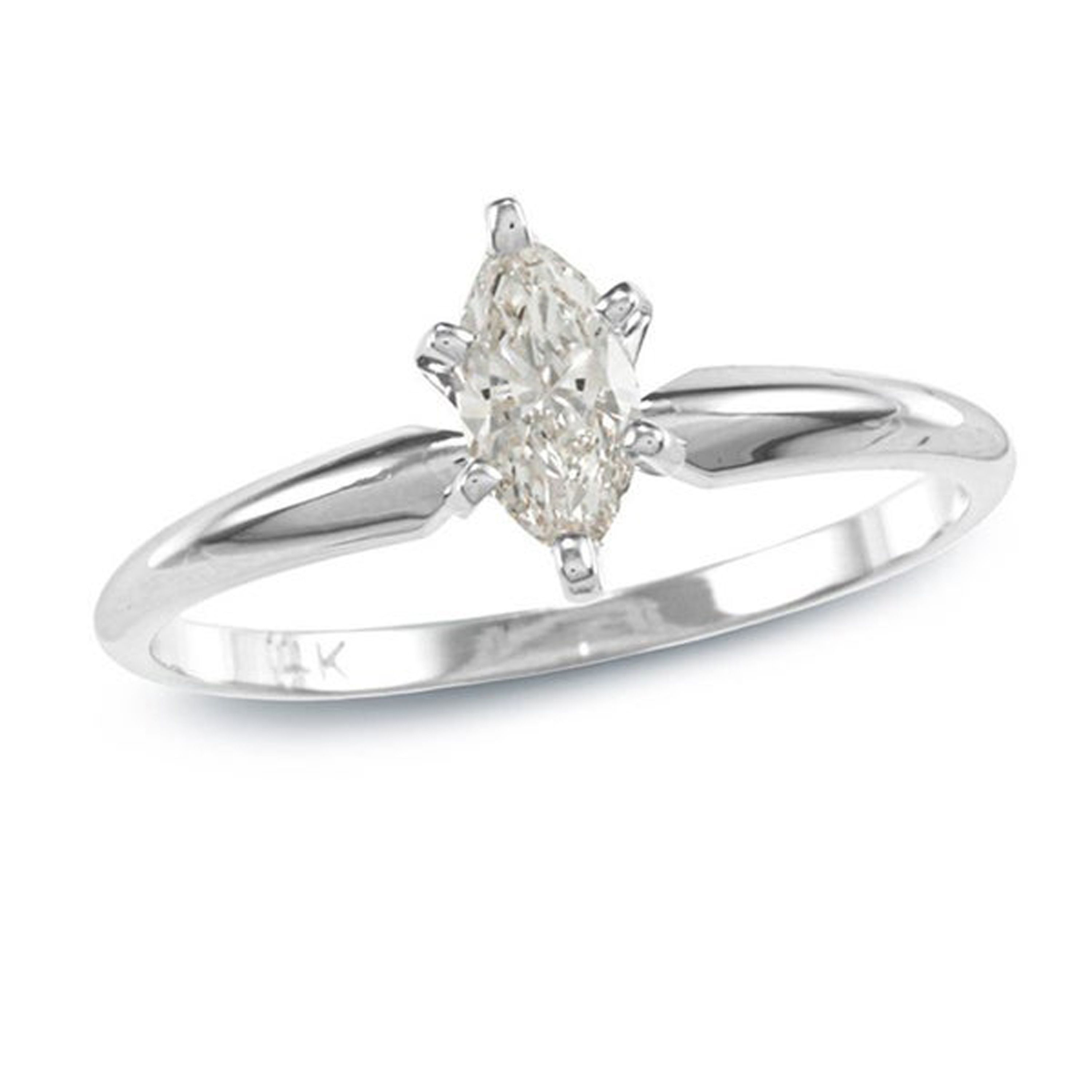 This Marquise-cut Solitaire Diamond Engagement Ring by Auriya showcases an elegant marquise diamond set in a quintessential 6-prong setting. The elongated shape gives an illusion of a greater size while accentuating the length of the finger.