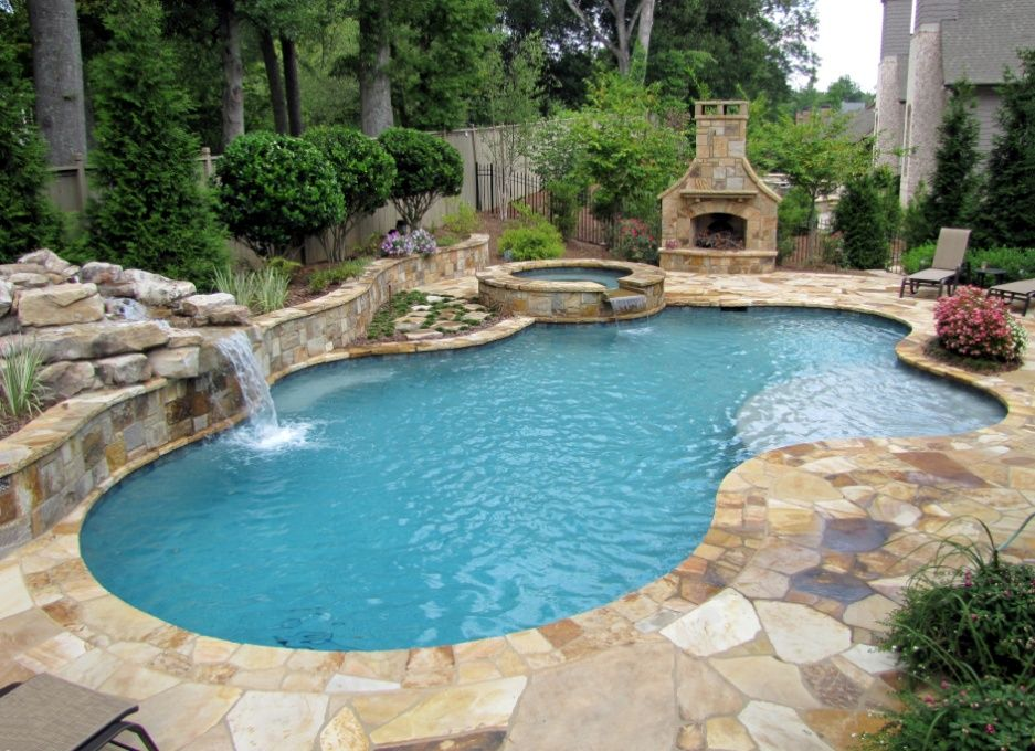 nice general feel of pool design includes many of our favorite elements sun shelf flagstone coping spa water feature and landscaping on backside of
