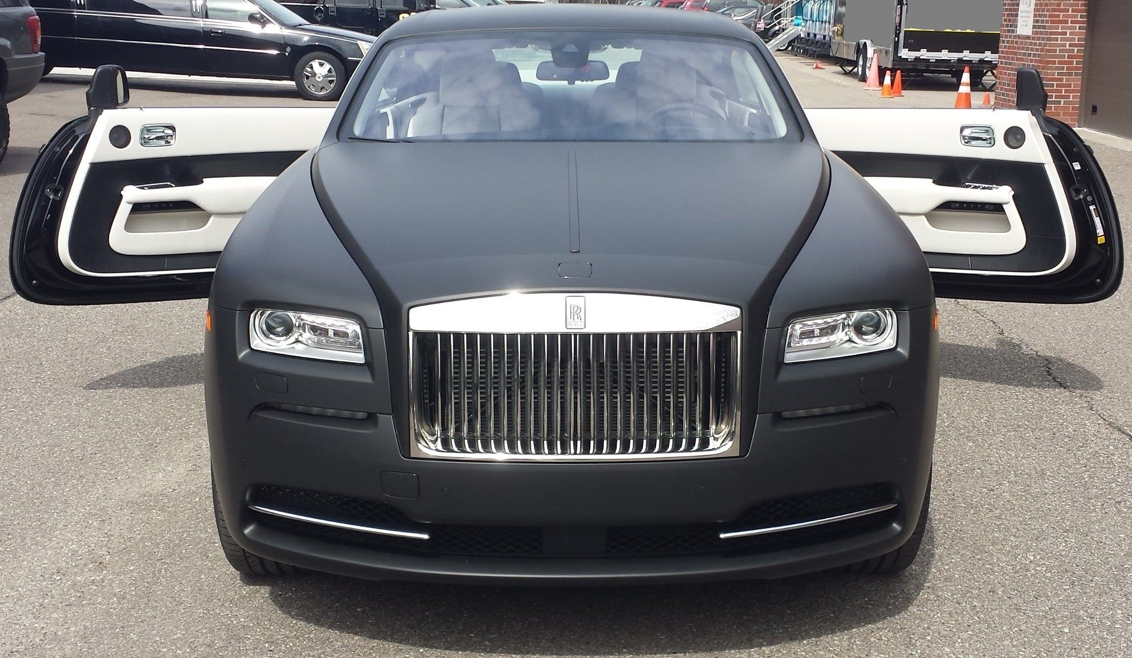Rolls Royce Wraith Full Flat Black Wrap Rollsroyce Rollsroycewraith Flatblack Suicidedoors Rolls Royce Rolls Royce Wraith Rolls Royce Suv